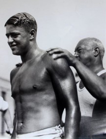 Duke Nelson gets a coating of grease applied by his trainer, Johnny Walker.