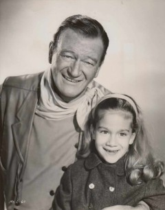 Aissa Wayne, right, appeared in films with her famous father when she was a child.