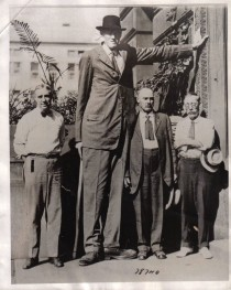 Bernard A. Coyne of Iowa stood 8 feet 2 inches tall and weighed 300 pounds. He died in 1921 at the age of 23.