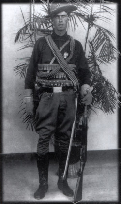 Emil Holmdahl, a native of Fort Dodge, epitomized the stereotype of a soldier of fortune in his mercenary regalia. Photo courtesy of the Holmdahl Papers.