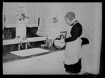 The wife of an Iowa farmer in Greene County, captured in this photo from April 1940, starts to make a cake. Photo courtesy of the Library of Congress, LC-USF34-060756-D.