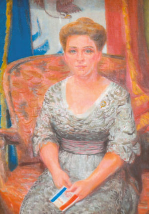 Dixie Cornell Gebhardt is credited for having helped create Iowa's flag 100 years ago. In 1956, Drake University art professor Leonard Good painted this posthumous portrait of Gebhardt at the request of the Iowa Daughters of the American Revolution. It currently hangs in the Iowa Governor's Formal Office. Photo courtesy of State Historical Society of Iowa