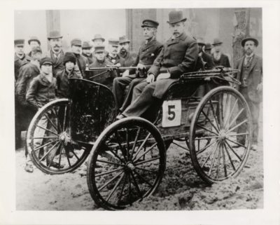 The winning car of the 1895 Chicago Times-Herald race, the Duryea Motorized Wagon, shown here on the occasion of the famous event. The Duryea car had a one-cylinder internal-combustion engine. Photographer unknown, Detroit Public Library Digital Collections